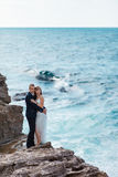 Bride and groom near the ocean. Hugging each other Royalty Free Stock Photos