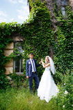 Bride and groom near old buildings Royalty Free Stock Photography