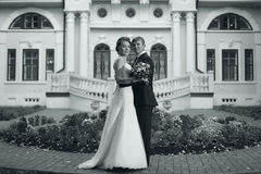 Bride and groom near old mansion Stock Photos