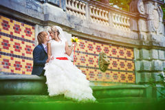 Bride and groom  near the patterned wall Royalty Free Stock Photography