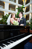 Bride and groom near the piano Stock Photo