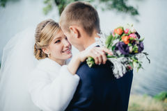 Bride and groom near the river Royalty Free Stock Photography