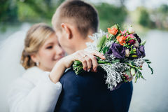 Bride and groom near the river Stock Photography
