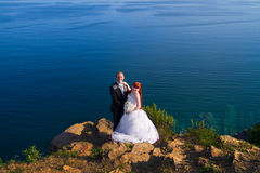 Bride and groom near the sea Royalty Free Stock Image