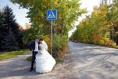 Bride and groom near the sign Stock Photo