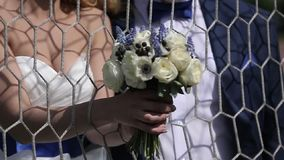 Bride and groom near soccer gate stock footage
