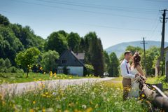 Bride and groom near to the road Stock Photography
