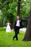 Bride and groom near trees in park Royalty Free Stock Photo