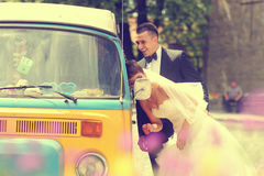 Bride and groom near a van Stock Image
