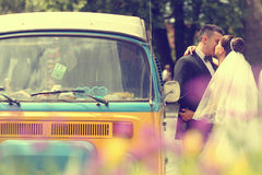 Bride and groom near a van Royalty Free Stock Image