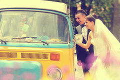 Bride and groom near a van Royalty Free Stock Images