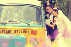 Bride and groom near a van Stock Photography