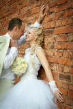 Bride and groom near the wall Stock Photo
