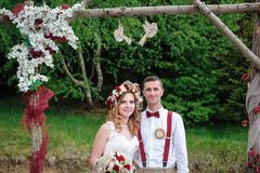 Bride and groom near wedding arch Stock Image