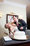 Bride and groom near wedding cake Stock Photos