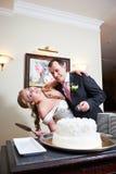 Bride and groom near wedding cake Stock Photos