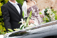 Spouse with wedding car. Bride and groom near wedding  car Royalty Free Stock Photos
