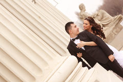 Bride and groom near white columns Stock Image