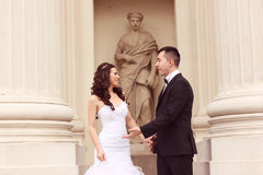 Bride and groom near white columns Royalty Free Stock Image