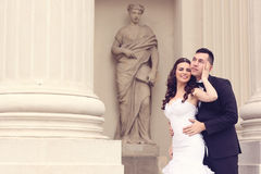 Bride and groom near white columns Royalty Free Stock Photos