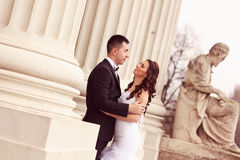 Bride and groom near white columns Royalty Free Stock Images