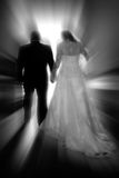 Bride & Groom - New Life Together 1. A bride & groom walk toward a new life together #1 (black & white, zoom special effect stock photo