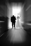 Bride & Groom - New Life Together 2. A bride & groom walk toward a new life together #2 (black & white, zoom special effect royalty free stock photos