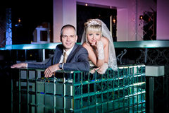 bride and groom next to bar Stock Photography