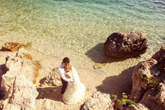 Bride and groom at the ocean Stock Image