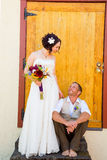 Bride and Groom with Old Doors Royalty Free Stock Images