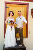 Bride and Groom with Old Doors Royalty Free Stock Image