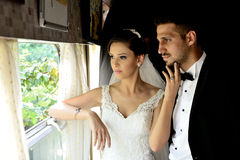 Bride and groom in a old train Royalty Free Stock Photo