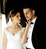 Bride and groom in a old train Royalty Free Stock Photography