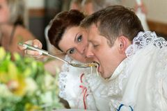 Bride and groom in one soup Royalty Free Stock Photography