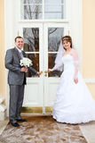 Bride and groom open doors Stock Photos