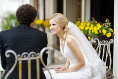 Bride and groom at outdoor cafe Stock Images