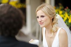 Bride and groom at outdoor cafe Stock Photos