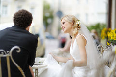 Bride and groom at outdoor cafe Royalty Free Stock Images