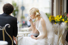 Bride and groom at outdoor cafe Royalty Free Stock Photography