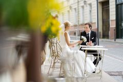 Bride and groom at outdoor cafe Stock Photo