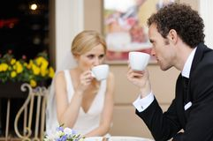 Bride and groom at outdoor cafe Royalty Free Stock Photo