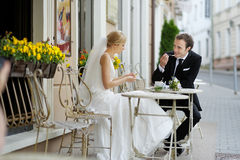 Bride and groom at outdoor cafe Stock Photography