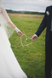 Bride and groom outdoor portrait with white heart Stock Photo