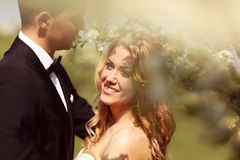 Bride and groom outdoors celebrating wedding day Royalty Free Stock Photos