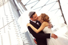 Bride and groom outdoors kissing on their wedding day Royalty Free Stock Photos