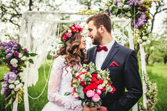 Bride and groom outdoors stock photography
