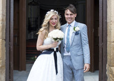 Bride and Groom outside the church Royalty Free Stock Images