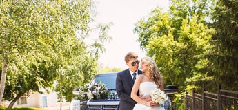 Bride and groom over wedding car background Stock Photo