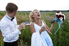 The bride and groom paint on an easel emotion Stock Photo