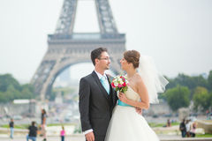 Bride and groom in Paris, near the Eiffel tower Stock Photo